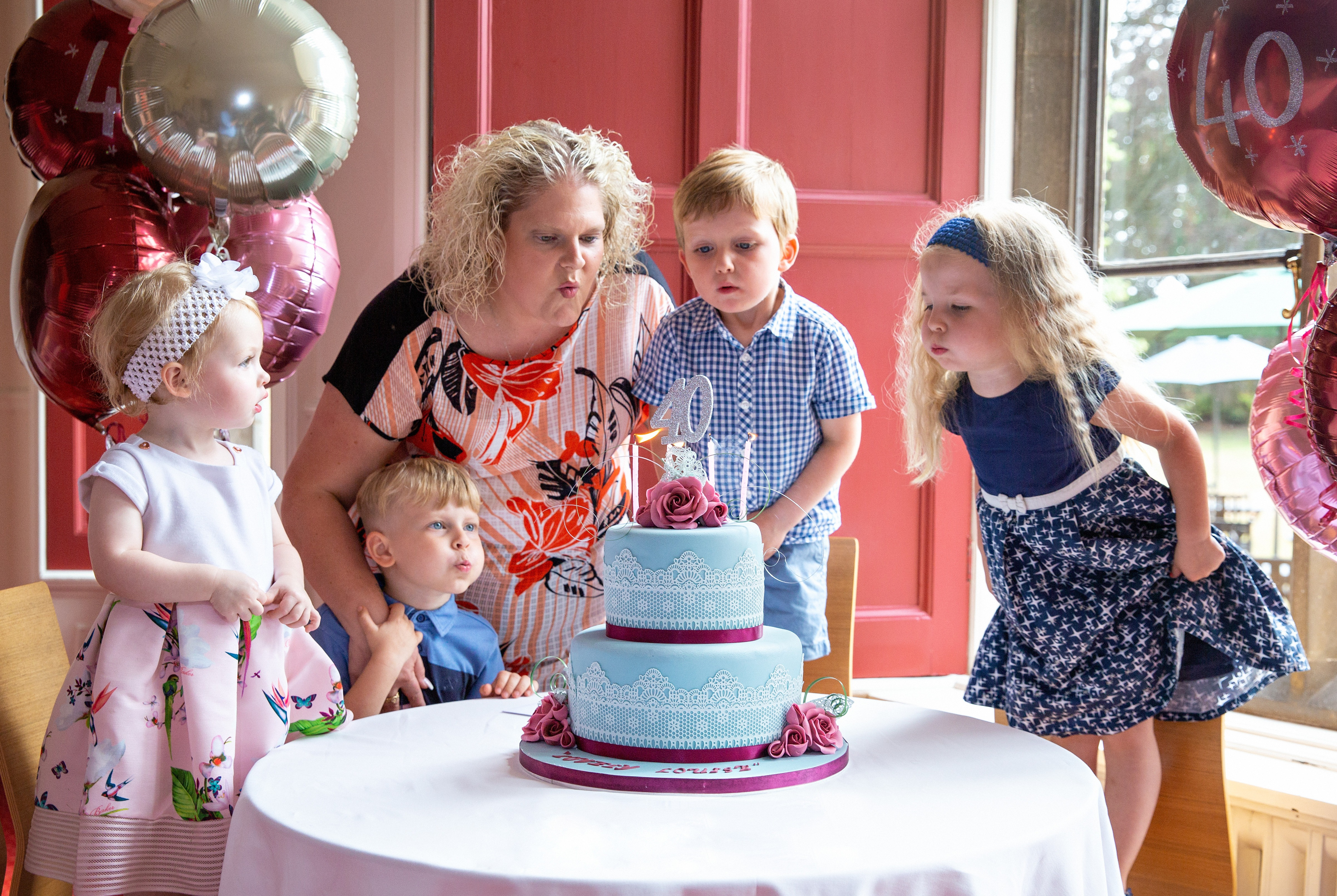 Louise Brown Blows Out Her 40th Birthday Cake Candles At Bourn Hall