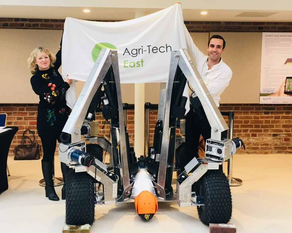 Belinda Clarke of Agri-Tech East and Sam Watson Jones from Small Robot Company reveal Harry at REAP 2018